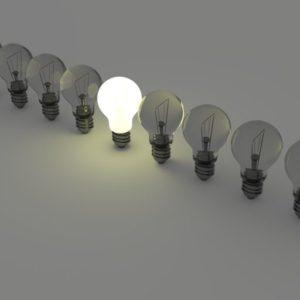 row of light bulbs with single lit light