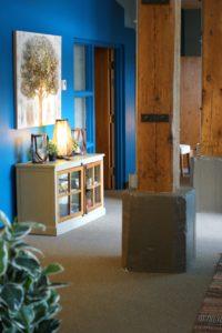 artistic bookshelf and rustic wooden beams